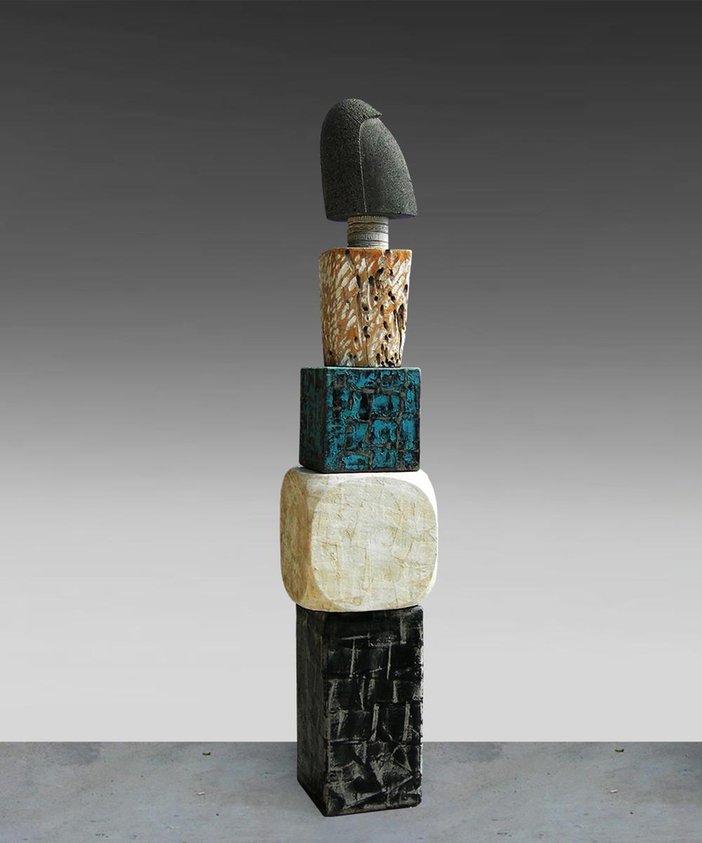 336-HOMO - 2020 volcanic stone| linestone| wood| cotton| pigment| beeswax| lead 146 x 27 x 27 cm